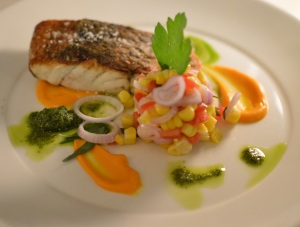 Roasted Cone Bay barramundi w carrot puree, sweet corn, eschalot, tarragon salad & rocket pesto