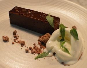 Chocolate moon cake w lemon whip & native mint