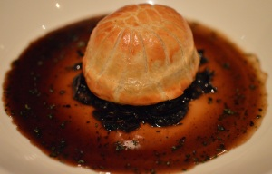 Braised lamb pie w garlic, mushrooms & tarragon jus