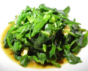 Stir-fried 'Coorong' Beach banana succulent w bower spinach, munyeroo w biodynamic garlic