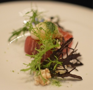Sashimi of Yellow fin tuna, layered with Jamón ibérico w poached quail egg, onion cream, puffed buckwheat, shiso jelly, elk leaf & fresh wasabi