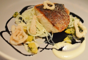 Pan seared Palmers Island Mulloway, calamari rings, confit potato noodles, orange, chive & squid ink dressing