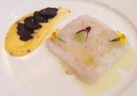 W.A Scampi carpaccio w Perigord truffle sabayon & bush herbs salad